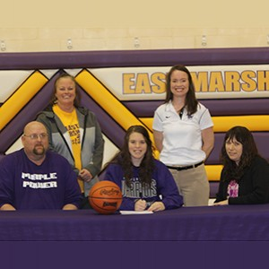 East Marshall's Taylor Fricke (center) signed with Waldorf on Thursday.