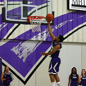 Trey Scott (above) led Waldorf with 20 points and nine assists in Saturday's 77-64 win over Oklahoma Wesleyan.