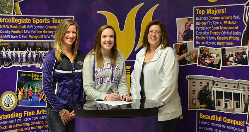 Brinna Rollefson (center), a 2013 Forest City graduate, signed with Waldorf on Friday.