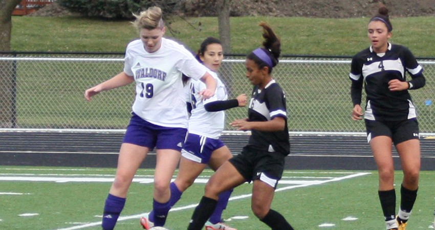 Waldorf�s Laura Moore (left) works to gain possession during Friday�s 3-1 loss to Bellevue.
