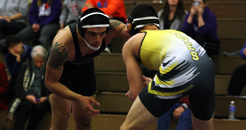 Waldorf's Dario Gamino (left) scored a fall at 149 pounds in Saturday's 32-21 loss to Ottawa.