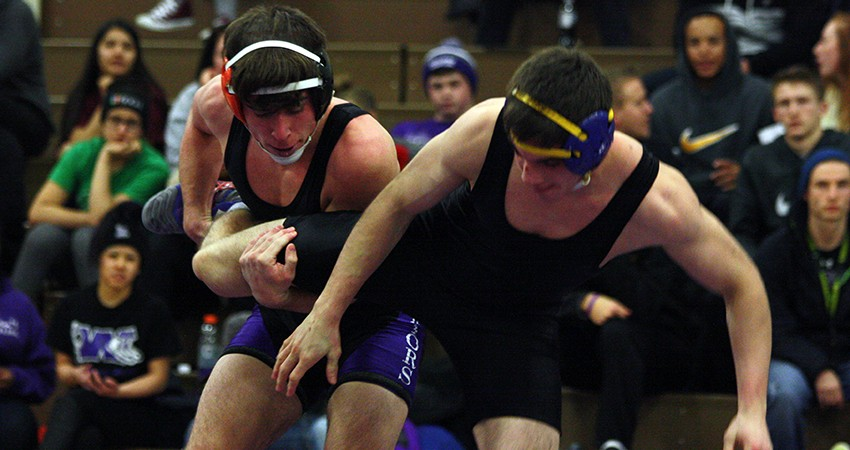 Waldorf's Zach Milks (left) earned a fall at 157 pounds in Wednedsay's 33-15 win over St. Olaf.