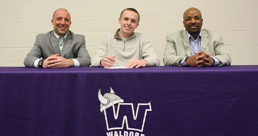 Mankato West standout Jake Dale (center) signed with Waldorf on Jan. 25.