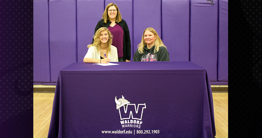 Forest City's Megan Cronkwright (front, left) signed with Waldorf last Thursday.