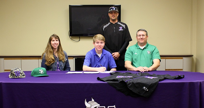 Reid Johnson (front, center), a senior from St. Edmond High School, signed with Waldorf last Wednesday.