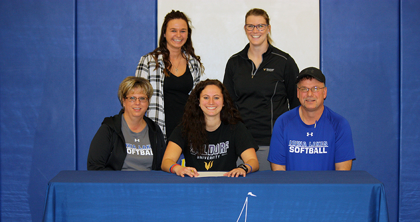 Blaney Markman (front, center), a transfer from Iowa Lakes, recently signed with Waldorf.