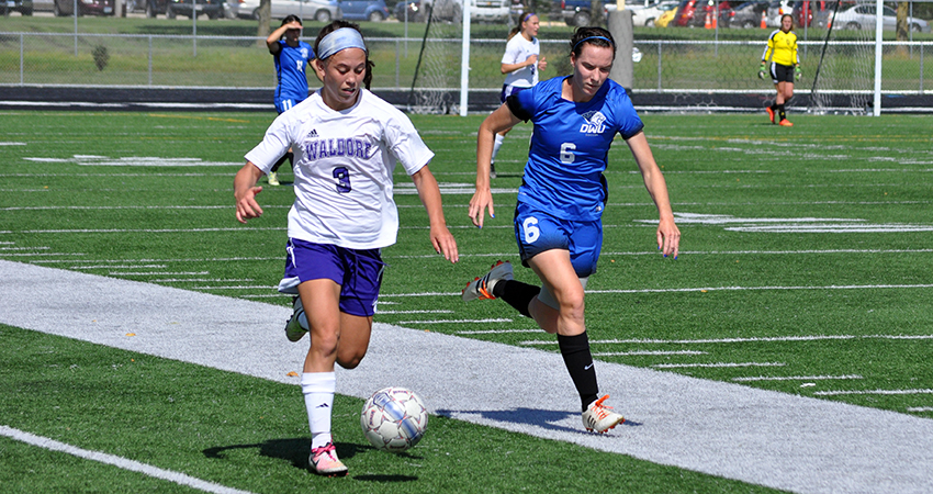 Waldorf's Brittney Thornton (left) scored a school-record five goals in Friday's 5-0 win.
