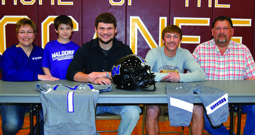 RCTC transfer Dakota Jahnke (center) signed with Waldorf on March 17. (Photo by Faribault County Register)