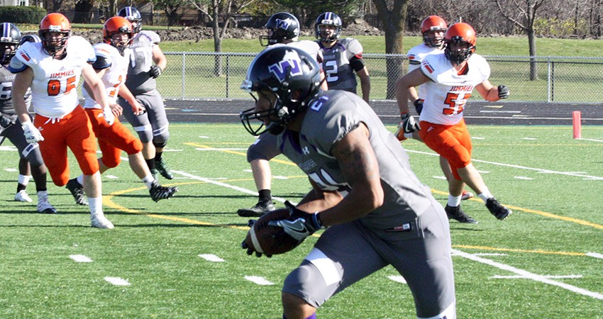 Waldorf's LaMont Johnson (center) hauls in a pass during Saturday's 20-14 loss to Jamestown.
