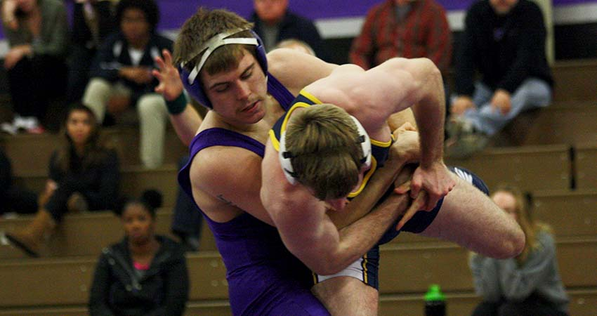 Waldorf's Taylor Lehman (left) placed fourth at 141 pounds during Saturday's Sioux City Dave Edmonds Open.