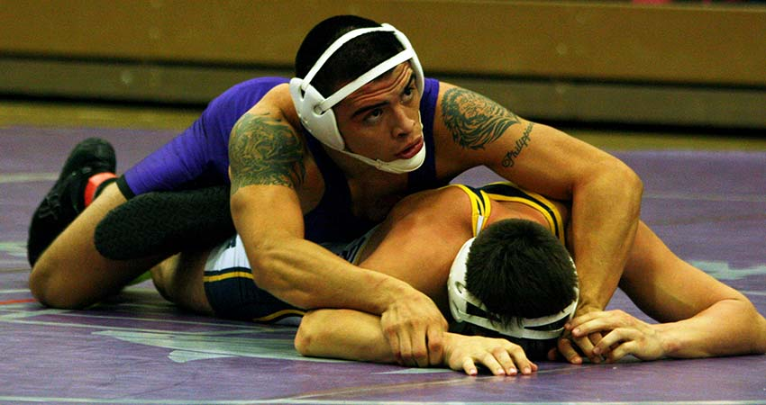 Waldorf's Dario Gamino (top) earned a 14-6 major decision at 157 during Wednesday's 30-19 loss to Graceland.