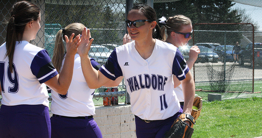 Taylor Navratil (center) finished 4-for-6 while helping Waldorf sweep Mount Marty on Sunday.