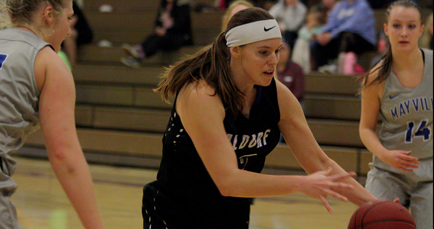 Waldorf's Taylor Fricke (center) scored 10 points in Saturday's 77-48 road loss to Mayville State.