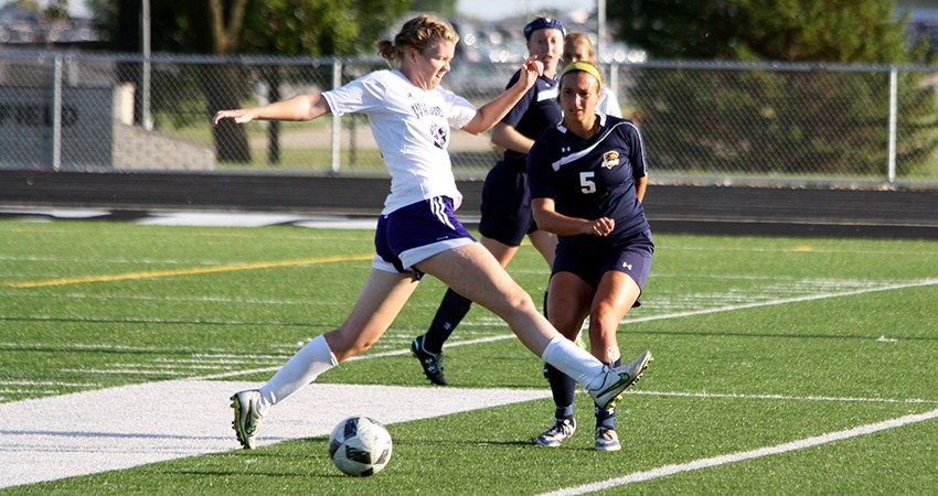 Waldorf's Laura Moore (above) battles for possession during Wednesday's 1-0 overtime loss to Clarke.