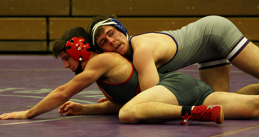 Waldorf's Taylor Lehman (top) scored an 11-2 major decision during Wednesday's 41-10 dual-meet loss to No. 18 Northwestern.
