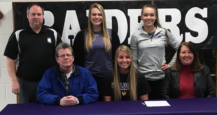 Collins-Maxwell senior Kathleen Baldwin (front, center) signed with Waldorf on Thursday.