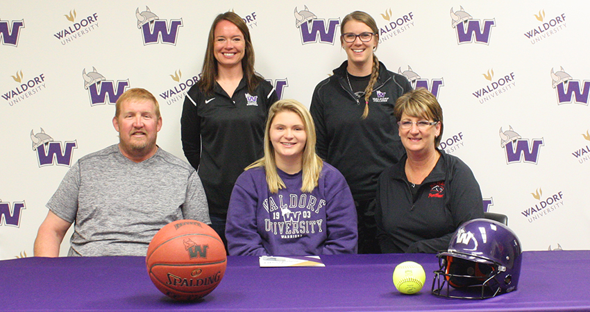 Ellendale, Minn. native Kayley Camerer (front, center), a senior from NRHEG High School, signed with Waldorf on April 23.