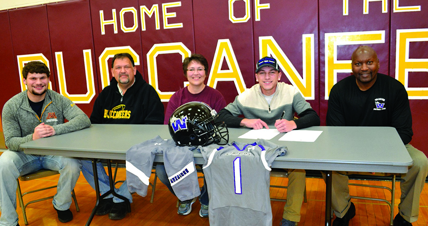 Blue Earth, Minn. native Logan Jahnke (fourth from left) signed with Waldorf on Jan. 20. (Photo by Faribault County Register)