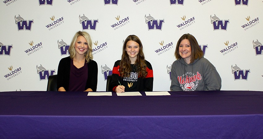 Mason City senior Madison Howe (center) signed with Waldorf on Oct. 7.