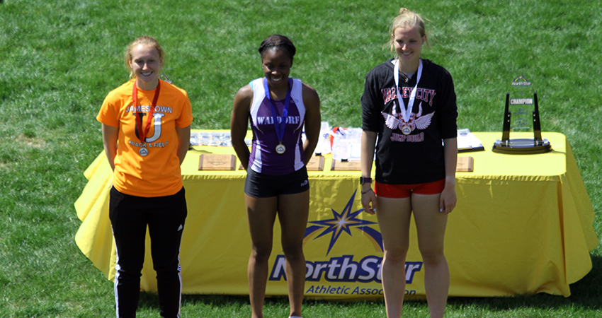 Waldorf's Markai Wotoe (center) secured the long jump crown and set an NSAA meet record on Friday.