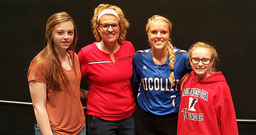Nicollet, Minn. native Natasha Young (third from left) signed with Waldorf's volleyball and women's basketball teams on May 1