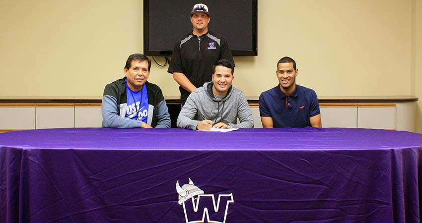 Nestor Jimenez (center), a junior transfer from Riverland, signed with Waldorf on Sept. 16.