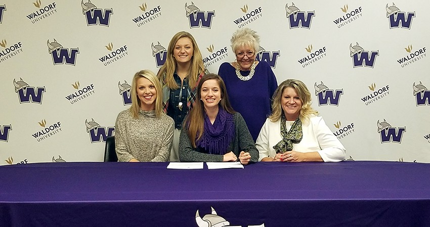 Somerset, Wis. native Savanna Nasgovitz (front, center) signed with Waldorf on Tuesday.