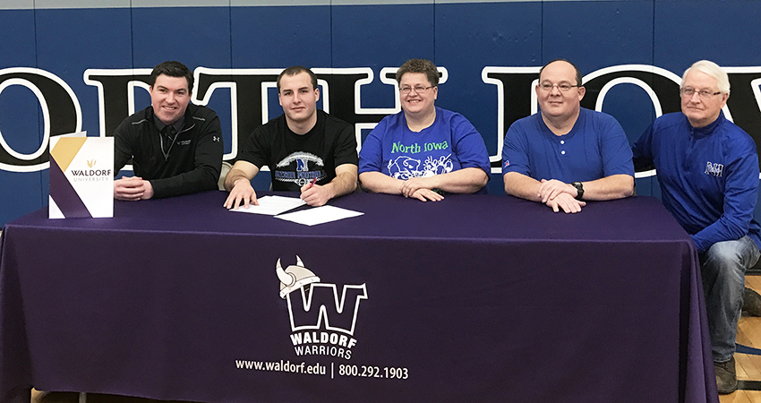North Iowa senior Spencer Armstrong (second from left) signed with Waldorf on Monday.