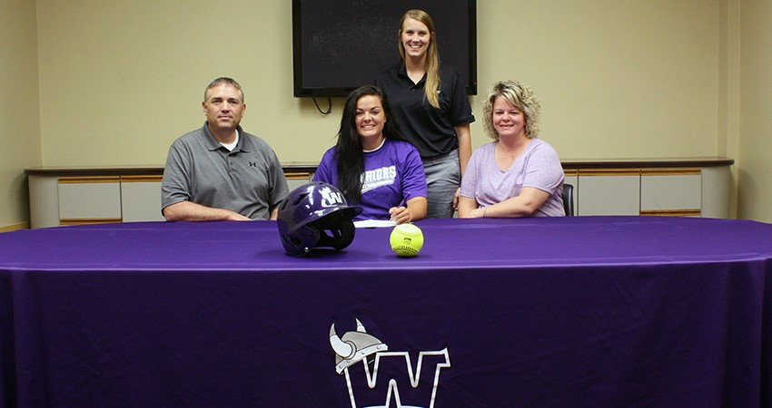 Tiernee Fichter (front, center), a transfer from Southwestern, signed with Waldorf last Friday.