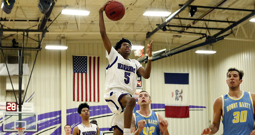 Leland March (center) led Waldorf with 19 points in Friday's 70-64 win over Mount Marty.