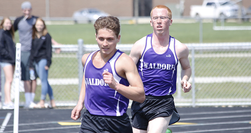 Aaron Ward (front) and Nathan Meiners were two of Waldorf's three runners to qualify for nationals on Saturday.
