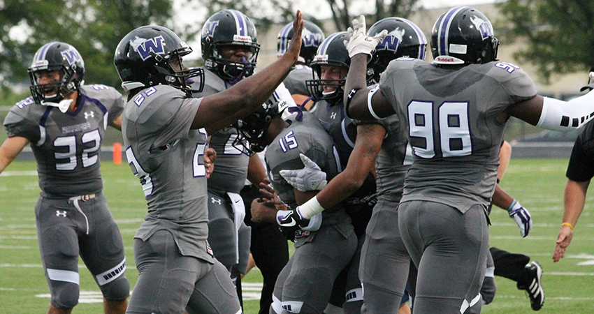 Waldorf's Jeremiah Jackson (center) blocked a punt to score a touchdown in Saturday's 62-26 win.